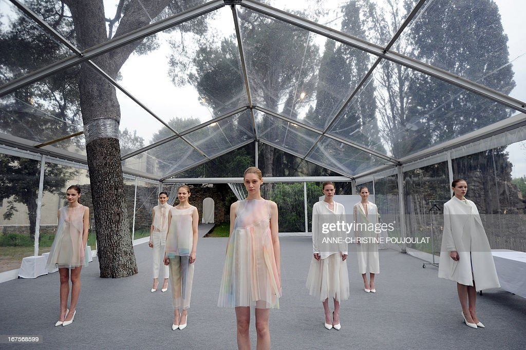 Models wearing creations by Chinese fashion designer Shanshan Ruan present to the jury on April 26, 2013, during the 28th edition of the International Festival of Fashion and Photography in the French southern city of Hyeres. This year's President of the Jury is Portuguese fashion designer Felipe Oliveira Baptista. AFP PHOTO /ANNE-CHRISTINE POUJOULAT