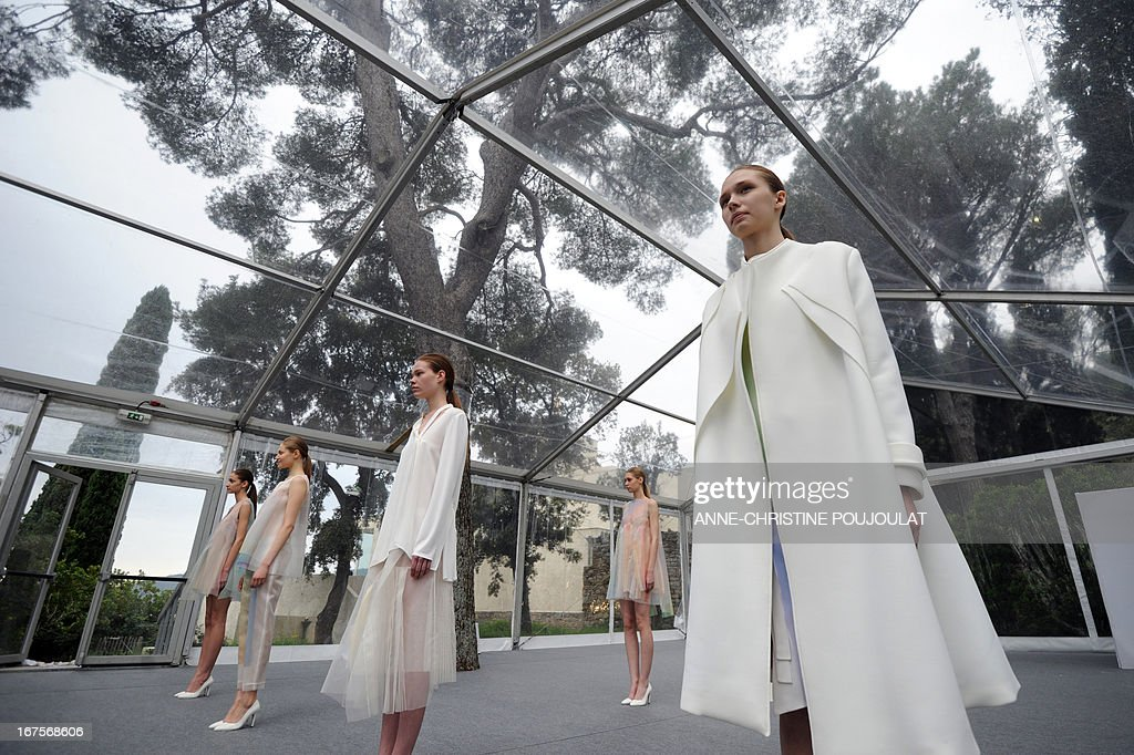 Models wearing creations by Chinese fashion designer Shanshan Ruan present to the jury on April 26, 2013, during the 28th edition of the International Festival of Fashion and Photography in the French southern city of Hyeres. This year's President of the Jury is Portuguese fashion designer Felipe Oliveira Baptista.