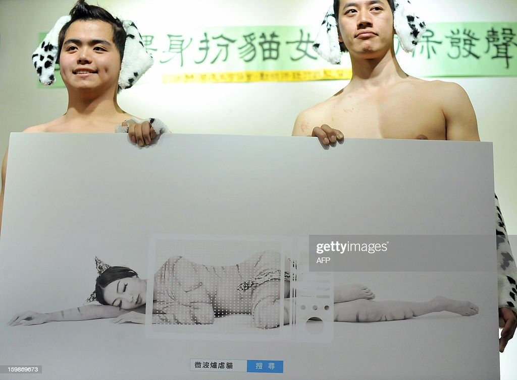 Models wearing dalmatian themed outfits hold a poster against animal abuse during a press conference also attended by Taiwanese singer Mina Lee (not pictured) in Taipei on January 22, 2013. The event, organised by a local animal protection group and endorsed by celebrities was aimed to help raise the public's awareness of animal rights and abuse, the group said on January 22. AFP PHOTO / Mandy CHENG