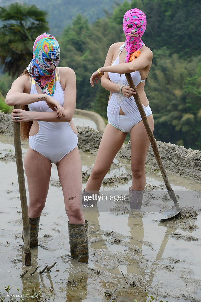 Models wearing face-kinis pose on the terraces of a farm on World Earth Day on April 22, 2015 in Loudi, Hunan province of China.