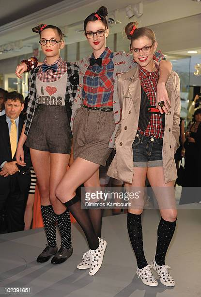 Models wearing Forever 21 pose during the Forever 21 Times Square opening celebration at Forever 21 Times Square Flagship Store on June 24 2010 in...