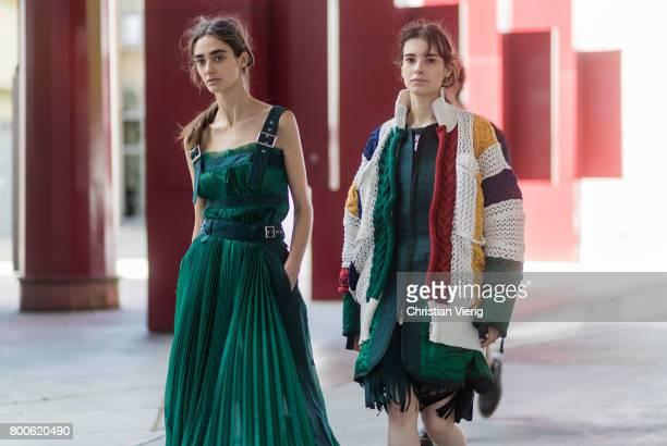 Models wearing Sacai outside Sacai during Paris Fashion Week Menswear Spring/Summer 2018 Day Four on June 24 2017 in Paris France