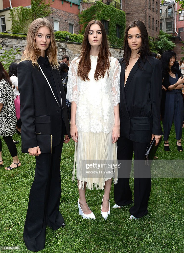 Models wearing Stella McCartney pose at the Stella McCartney Resort 2013 Presentation at Stella McCartney Store on June 11, 2012 in New York City.
