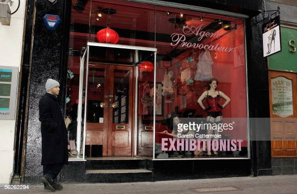Models wearing underwear by luxury lingerie brand Agent Provocateur perform in a live window display to marks tomorrow's publication of new book...