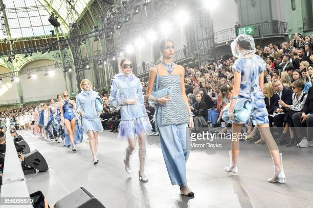 Models wide shot walk the runway during the finale of the Chanel Paris show as part of the Paris Fashion Week Womenswear Spring/Summer 2018 on...