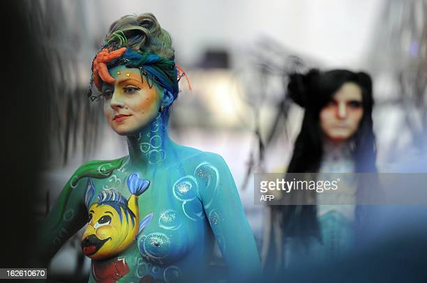 Models with artwork painted on their bodies attend a body art show at the Nevskie Berega international art festival in the Russia's second city of...