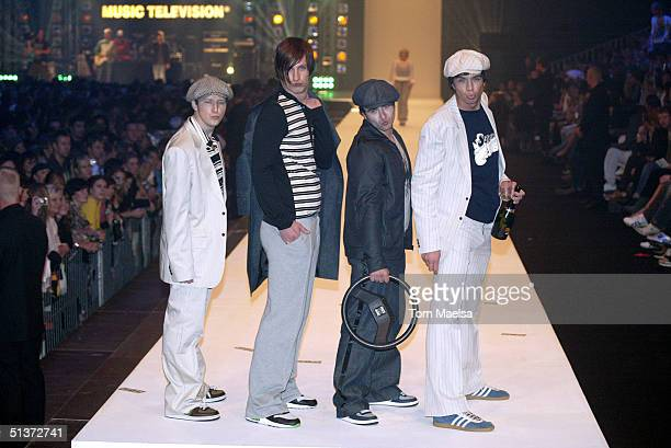 Models with FKK walk the runway at the MTV Designerama Fashion Show in Hanger 2 at Berlin's Tempelhof airport on September 29 2004 in Berlin Germany