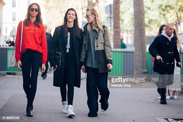 Models Yasmin Wijnaldum Vittoria Ceretti and Jess PW after the Sacai show at Palais de Tokyo on October 03 2016 in Paris France Yasmin wears a red...
