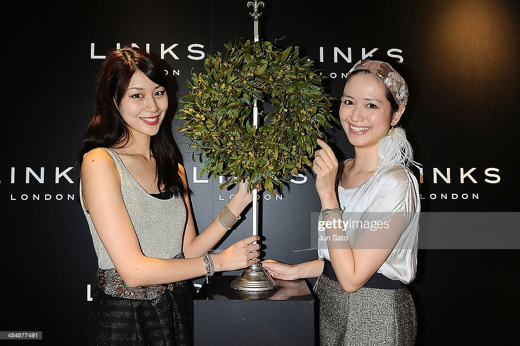 Models Yayoi Ando and Tamami Noguchi attend the Links of London Christmas Party on December 9, 2013 in Tokyo, Japan.