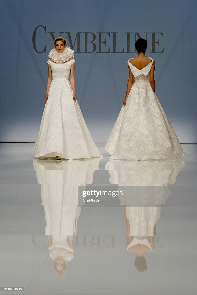 Modelsl walk the runway presenting a wedding dress during the Cymbeline catwalk show at the Bridal Fashion Week in Barcelona (Spain) on 29 April, 2016.