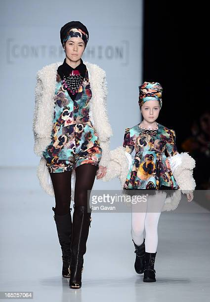 Modelsl wearing TaiDo walk the runway at the Contrfashion show during MercedesBenz Fashion Week Russia Fall/Winter 2013/2014 at Manege on April 2...