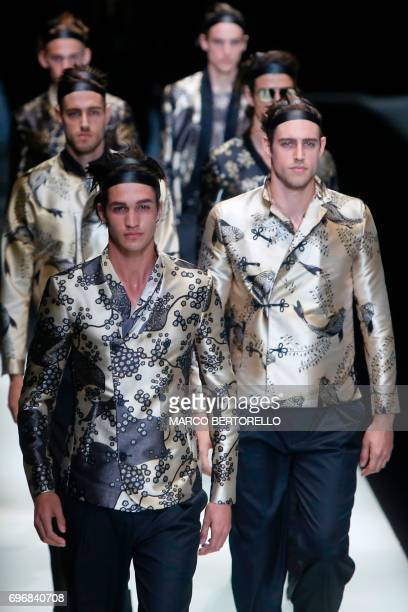 Modelspresent creations for fashion house Emporio Armani during the Men's Spring/Summer 2018 fashion shows in Milan on June 17 2017 / AFP PHOTO /...