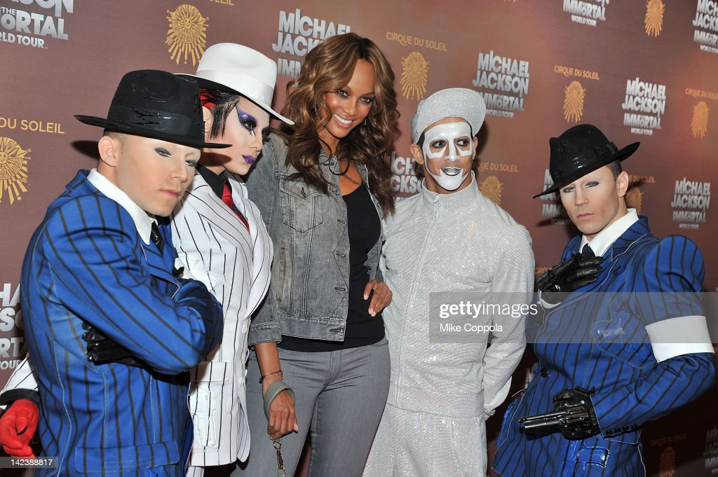 Model/television personality <a gi-track='captionPersonalityLinkClicked' href=/galleries/search?phrase=Tyra+Banks&family=editorial&specificpeople=202216 ng-click='$event.stopPropagation()'>Tyra Banks</a> (2nd from L) poses for a picture with Cirque du Soleil cast members for Michael Jackson the Immortal World Tour of at Madison Square Garden on April 3, 2012 in New York City.