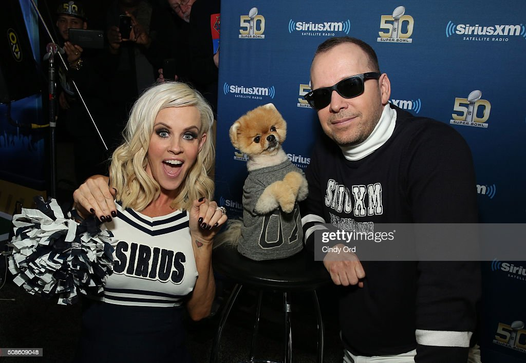 Model/TV host Jenny McCarthy, Jiffpom and actor Donnie Wahlberg visit the SiriusXM set at Super Bowl 50 Radio Row at the Moscone Center on February 5, 2016 in San Francisco, California.