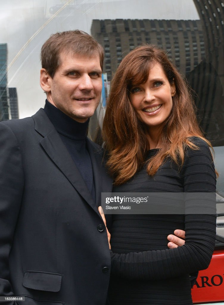 Model/TV personality Carol Alt and boyfriend Alexei Yashin attend Gray Line New York 'Ride Of Fame' Induction Ceremony For Supermodel Carol Alt on October 7, 2013 in New York City.