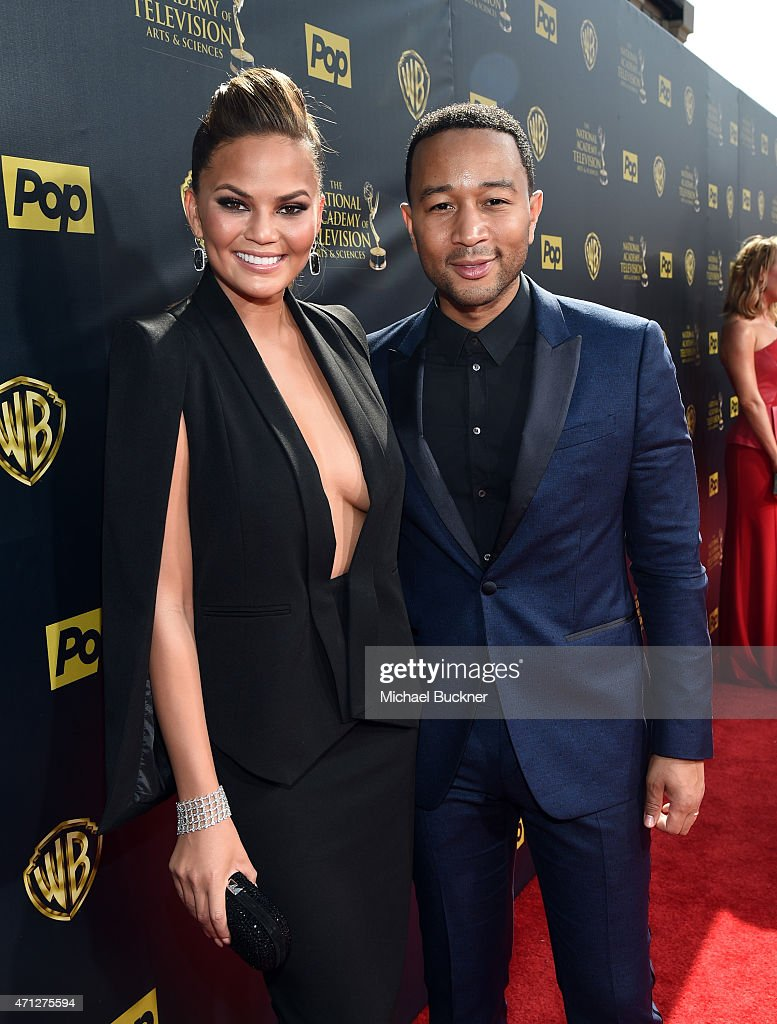 Model/TV personality Chrissy Teigen and recording artist John Legend attend The 42nd Annual Daytime Emmy Awards at Warner Bros Studios on April 26...