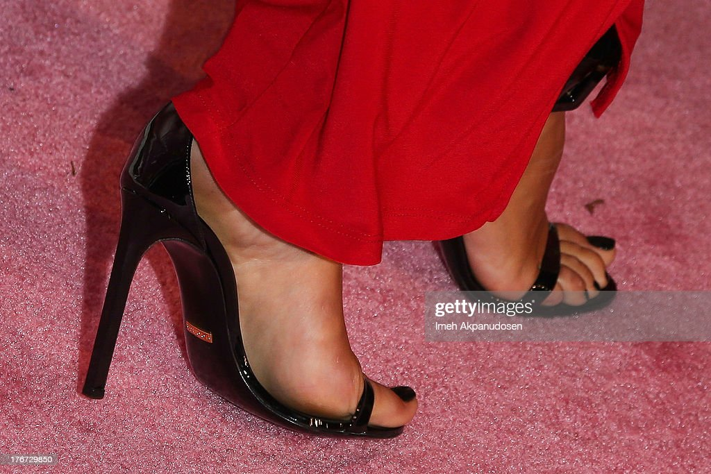 Model/TV personality Nabilla Benattia (shoe detail) attends the 8th Annual Kandyland - An Evening Of Decadent Dreams on August 17, 2013 in Beverly Hills, California.