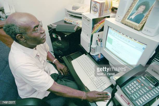 MODEMBenjamin Tolliver an Alexandria resident and retired terminal supervisor with the Metro subway checks his credit card balance on the Internet...