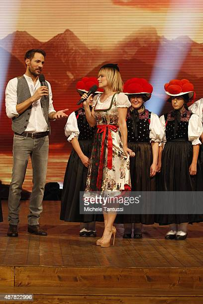 Moderator Alexander Mazza and Francine Jordi with a group of woman wearing traditional Costumes of the Black forest during the dress rehearsal of the...