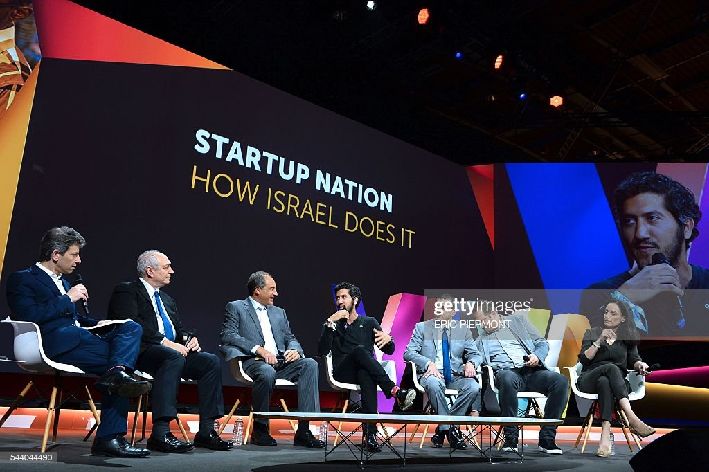 Moderator and Internet entrepreneur Yossi Vardi, Chemi Peres, Managing General Partner and Co-Founder of Pitango Venture Capital, Edouard Cukierman, founder and Managing Partner of Catalyst Investments, Adam Singolda, founder and CEO of Taboola, Amit Lang, Director General at the Israeli Ministry of Commerce and Industry, Zack Weisfeld, founder and General Manager of Microsoft Global Accelerators and Reem Younis, co-founder of Alpha Omega attend the session 'Startup nation - how Israel Does it' at the Viva technology event in Paris on July 1st, 2016. / AFP / ERIC
