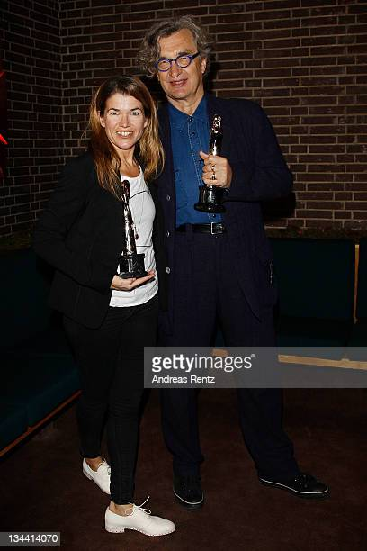 Moderator Anke Engelke and Wim Wenders President of the European Film Awards pose with the awards during a photocall for the upcoming 24th European...