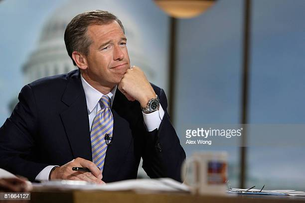 Moderator Brian Williams watches a video which pays tribute to late moderator Tim Russert during a taping of 'Meet the Press' at the NBC studios June...