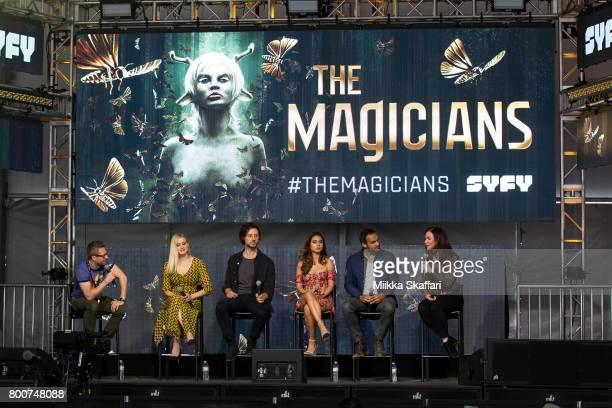 Moderator Chris Hardwick actors Olivia Taylor Dudley Hale Appleman Summer Bishil Arjun Gupta and writer Sera Gamble talk at The Magicians panel at...