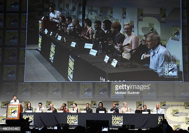 Moderator Chris Hardwick producer Kathleen Kennedy director JJ Abrams screenwriter Lawrence Kasdan and actors John Boyega Daisy Ridley Oscar Isaac...