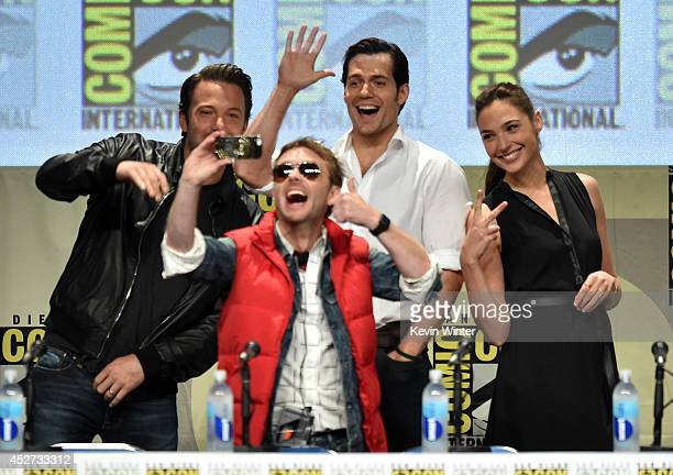 Moderator Chris Hardwick takes a selfie with actors Ben Affleck Henry Cavill and Gal Gadot at the Warner Bros Pictures panel and presentation during...