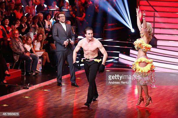 Moderator Daniel Hartwich Isabel Edvardsson and Alexander Klaws seen on stage during the 5th show of 'Let's Dance' on RTL at Coloneum on May 2 2014...