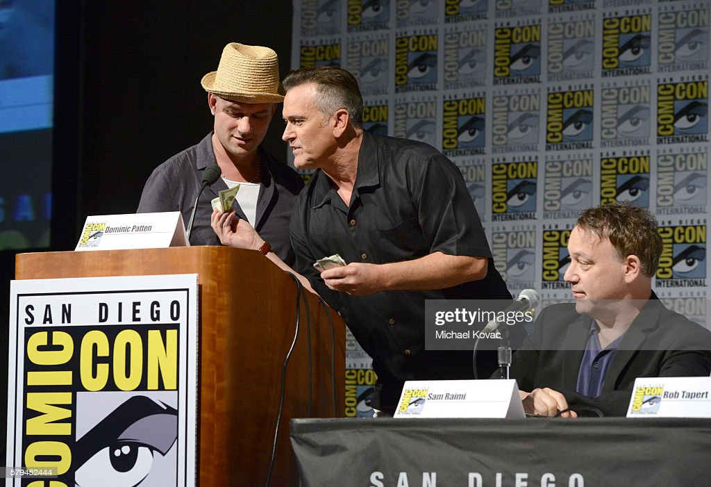 Moderator Dominic Patten actor Bruce Campbell and director Sam Raimi speaks on stage during the 'Ash vs Evil Dead' panel during ComicCon...