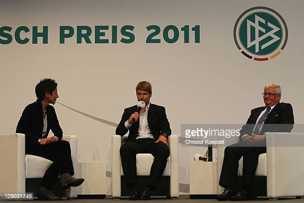 Moderator Dunja Hayali honorary prize winner of the Julius Hirsch award Thomas Hitzlsperger and Theo Zwanziger president of the German Football...