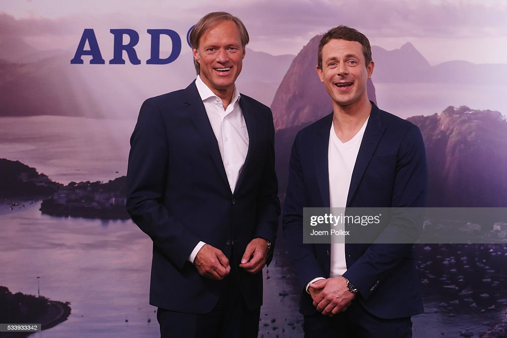 ARD moderator Gerhard Delling (L) and ARD moderator Alexander Bommes pose during a photocall prior to the ARD and ZDF Olympics 2016 Press Conference at Empire Riverside Hotel on May 24, 2016 in Hamburg, Germany.