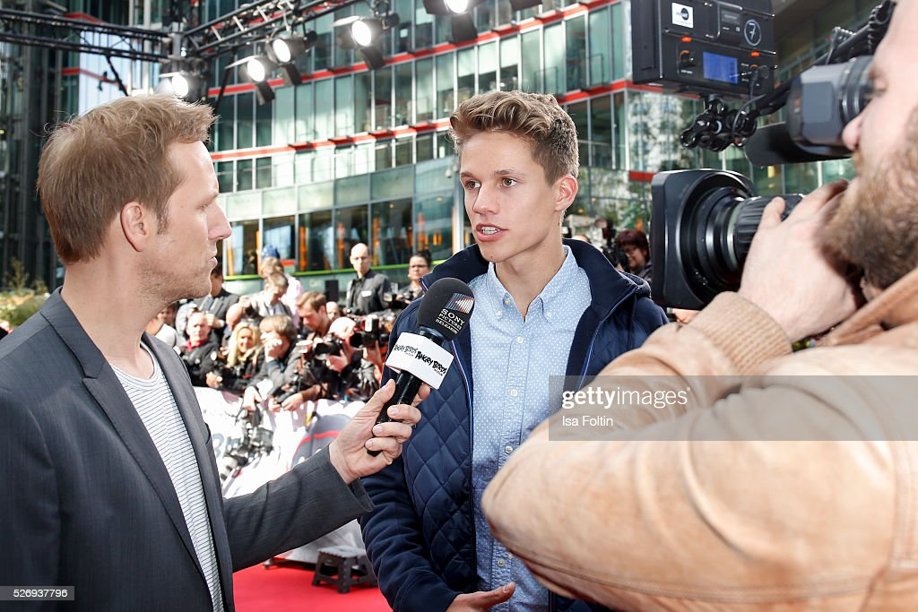 Moderator Jan Hahn with Luca aka ConCrafter during the Berlin premiere of the film 'Angry Birds - Der Film' at CineStar on May 1, 2016 in Berlin, Germany.