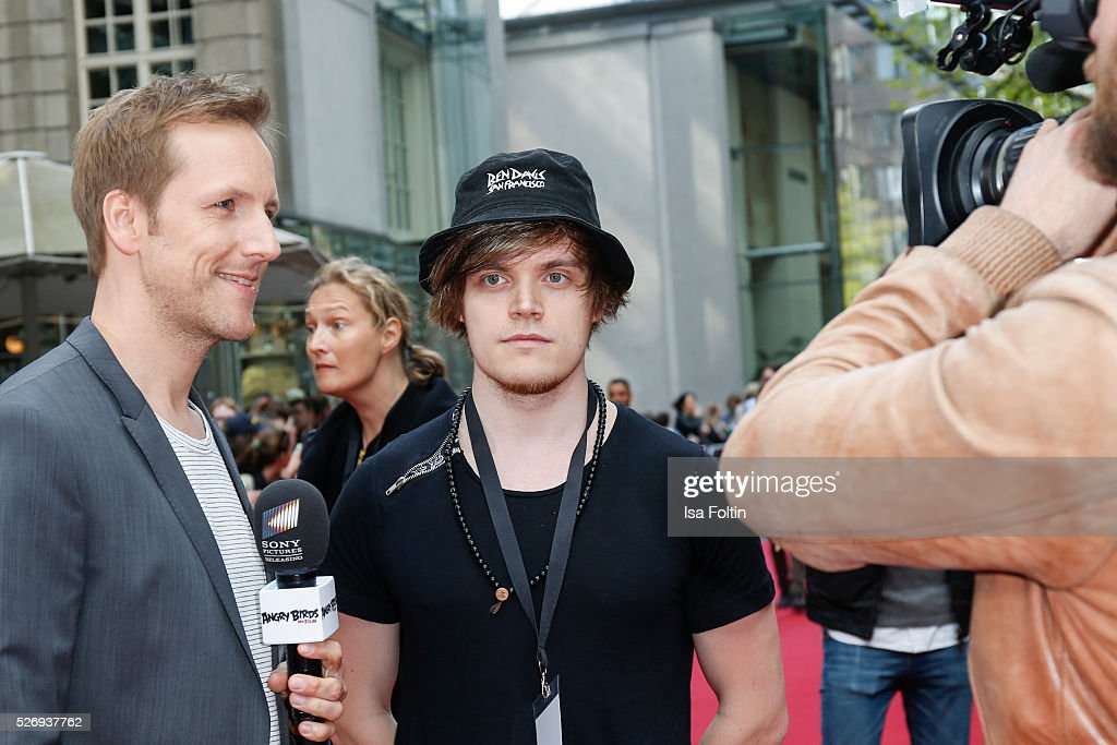 Moderator Jan Hahn with youtube star Viktor aka iBlali during the Berlin premiere of the film 'Angry Birds - Der Film' at CineStar on May 1, 2016 in Berlin, Germany.