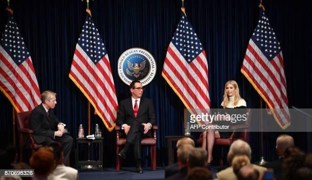 Moderator John Heubusch looks on as US Treasury Secretary Steve Mnuchin and Advisor to US President Donald Trump Ivanka Trump discuss tax reform at...