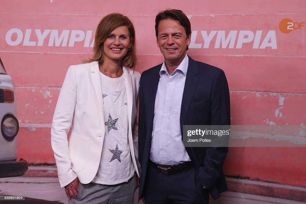 ZDF moderator Katrin Mueller-Hohenstein (L) and Rudi Cerne (R) pose during a photocall prior to the ARD and ZDF Olympics 2016 Press Conference at Empire Riverside Hotel on May 24, 2016 in Hamburg, Germany.