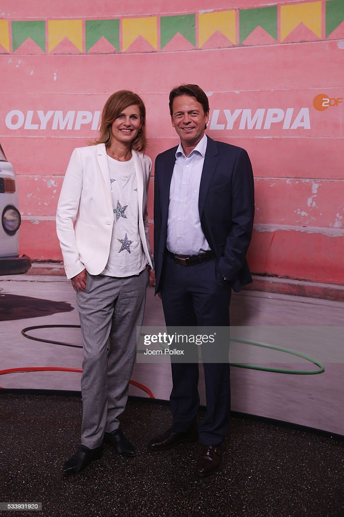 ZDF moderator <a gi-track='captionPersonalityLinkClicked' href=/galleries/search?phrase=Katrin+Mueller-Hohenstein&family=editorial&specificpeople=695142 ng-click='$event.stopPropagation()'>Katrin Mueller-Hohenstein</a> (L) and Rudi Cerne (R) pose during a photocall prior to the ARD and ZDF Olympics 2016 Press Conference at Empire Riverside Hotel on May 24, 2016 in Hamburg, Germany.