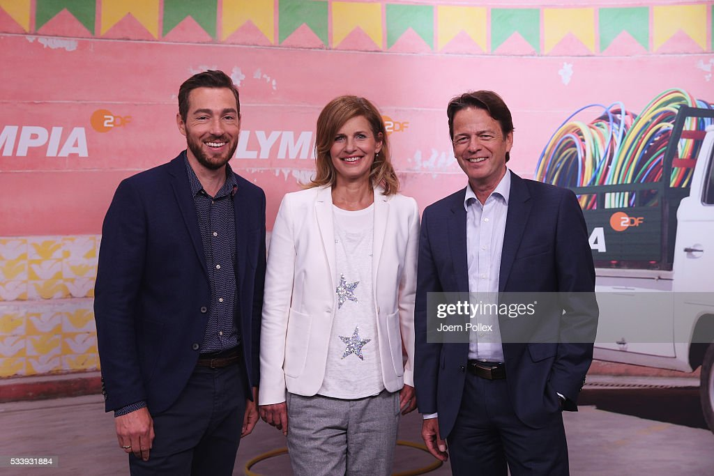 ZDF moderator Katrin Mueller-Hohenstein (M), Rudi Cerne (R) and Sven Voss (L) pose during a photocall prior to the ARD and ZDF Olympics 2016 Press Conference at Empire Riverside Hotel on May 24, 2016 in Hamburg, Germany.