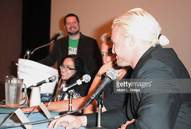 Moderator Mo Lightning wrestlers AJ Lee Ricky 'The Dragon' Steamboat and Dolph Ziggler attends Day 3 of Wizard World Chicago Comic Con held at Donald...
