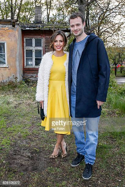 TV moderator Nazan Eckes wearing a dress of COS and her husband Julian Khol attend the presentation of a joint project by COS and Michael Sailstorfer...