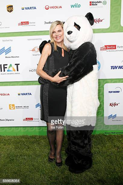 Moderator Nina Ruge with the Green Tec Mascot attend the Green Tec Award at ICM Munich on May 29 2016 in Munich Germany