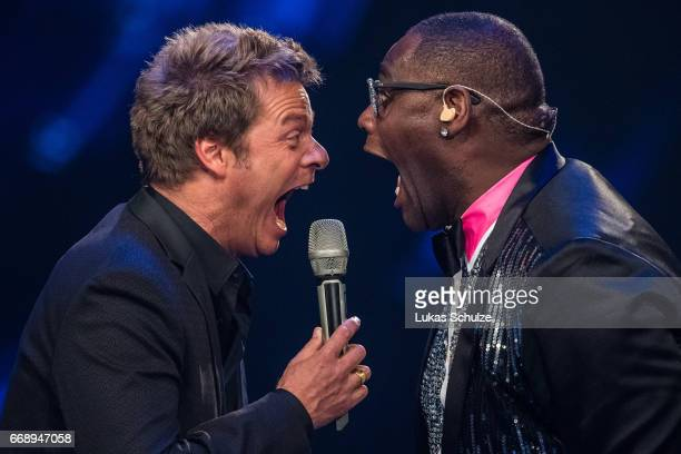 Moderator Oliver Geissen and Alphonso Williams perform during the second event show of the tv competition 'Deutschland sucht den Superstar' at...