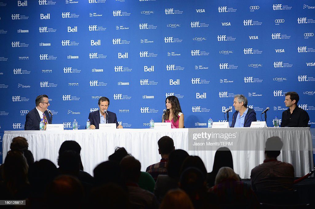 Moderator Richard Crouse, producer <a gi-track='captionPersonalityLinkClicked' href=/galleries/search?phrase=David+Heyman&family=editorial&specificpeople=810485 ng-click='$event.stopPropagation()'>David Heyman</a>, actress <a gi-track='captionPersonalityLinkClicked' href=/galleries/search?phrase=Sandra+Bullock&family=editorial&specificpeople=202248 ng-click='$event.stopPropagation()'>Sandra Bullock</a>, director <a gi-track='captionPersonalityLinkClicked' href=/galleries/search?phrase=Alfonso+Cuaron&family=editorial&specificpeople=213792 ng-click='$event.stopPropagation()'>Alfonso Cuaron</a> and screenwriter Jonas Cuaron speak onstage at 'Gravity' Press Conference during the 2013 Toronto International Film Festival at TIFF Bell Lightbox on September 9, 2013 in Toronto, Canada.