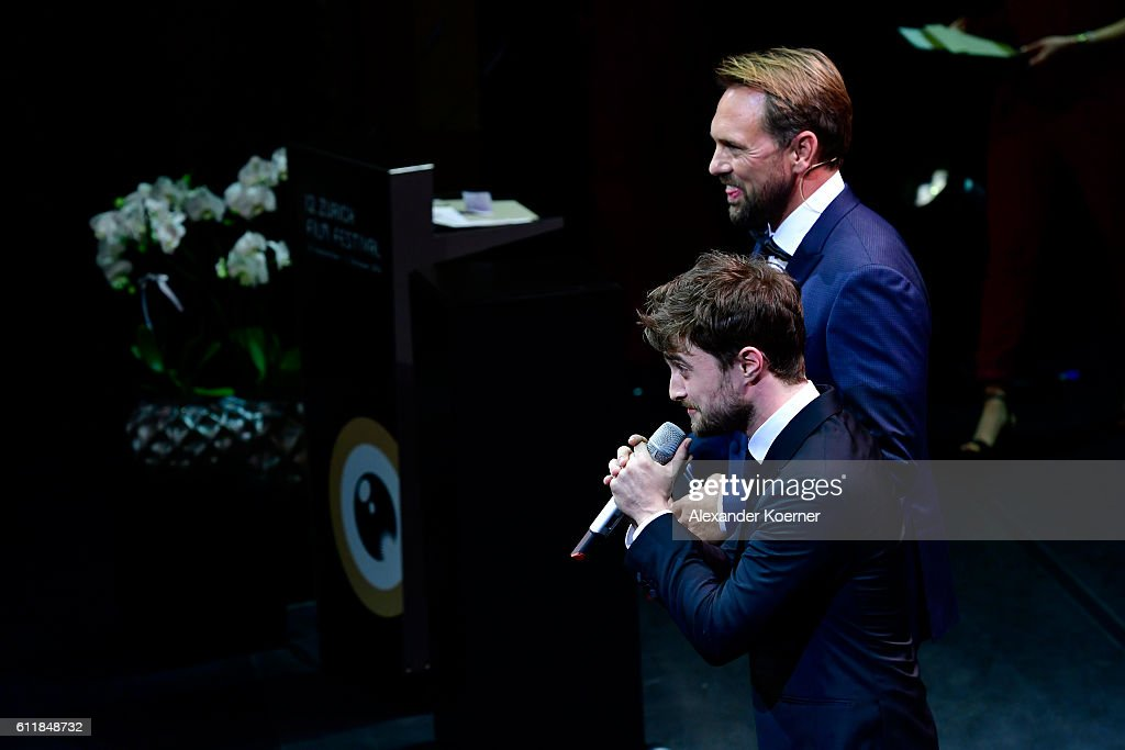 Moderator Steven Gaetjen and Daniel Radcliffe present the award for international documentary on stage during the Award Night Ceremony during the 12th Zurich Film Festival on October 1, 2016 in Zurich, Switzerland. The Zurich Film Festival 2016 will take place from September 22 until October 2.