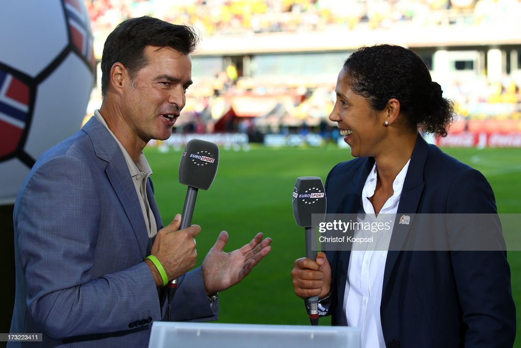 Moderator Thomas Berthold of Eurosport Television channel and Ambassador <a gi-track='captionPersonalityLinkClicked' href=/galleries/search?phrase=Steffi+Jones+-+Fu%C3%9Fballspielerin&family=editorial&specificpeople=226998 ng-click='$event.stopPropagation()'>Steffi Jones</a> talk prior to the UEFA Women's EURO 2013 Group A match between Sweden and Denmark at Gamla Ullevi Stadium on July 10, 2013 in Gothenburg, Sweden.