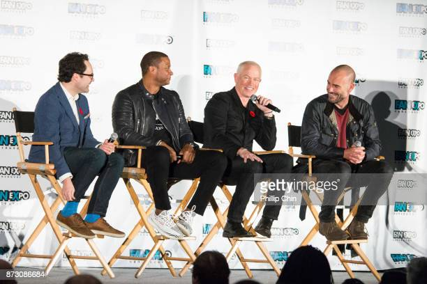 Moderator Thor Diakow talks with actors David Ramsey Neal McDonough and Paul Blackthorne at 'The Arrow' QA for Fan Expo Vancouver in the Vancouver...