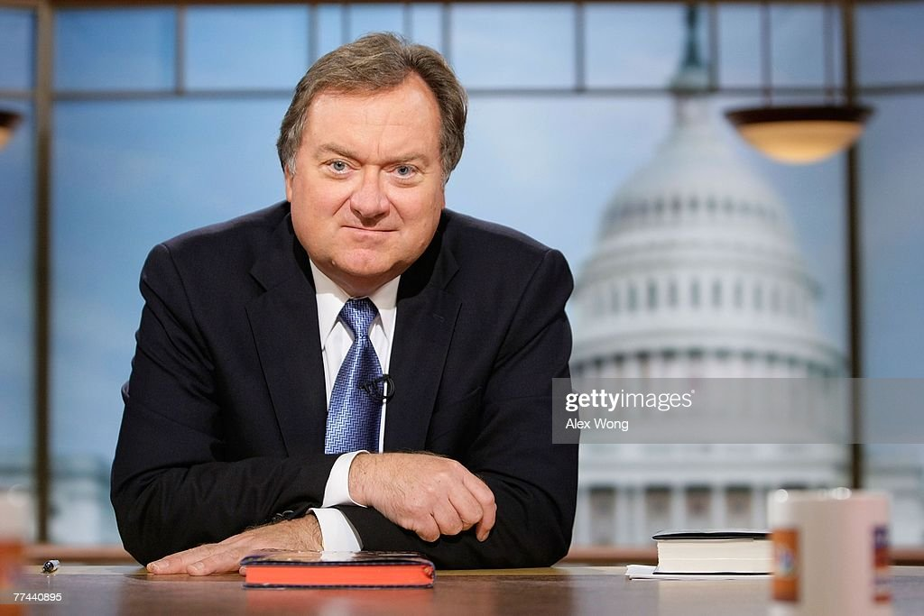 Moderator Tim Russert listens during a taping of 'Meet the Press' at the NBC studios October 21 2007 in Washington DC 'Meet the Press' will celebrate...