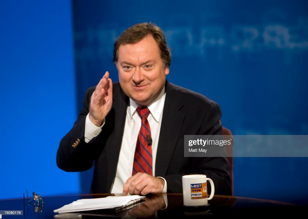 Moderator Tim Russert signs off after an interview with Republican US presidential hopeful Sen John McCain during a taping of 'Meet the Press' on...