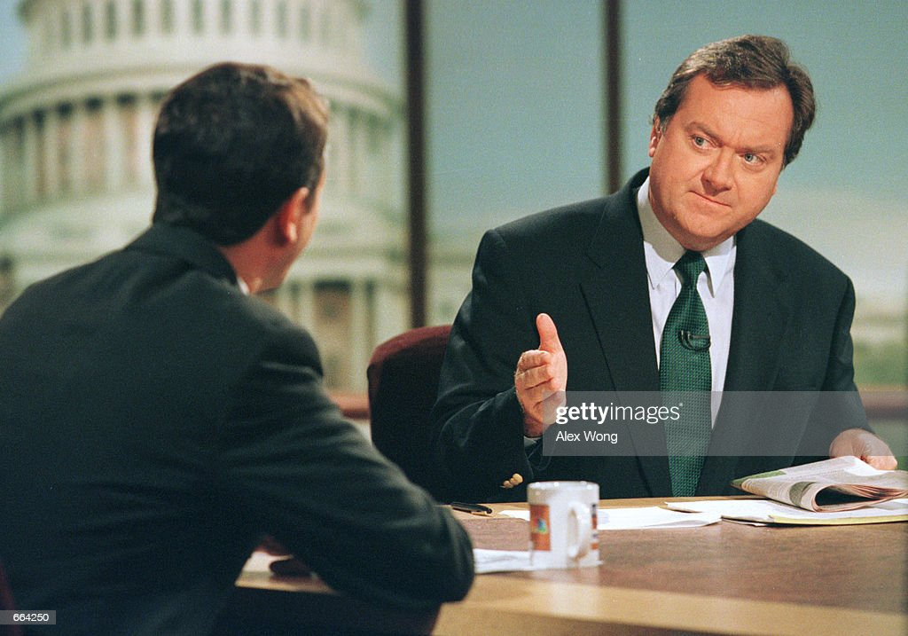Moderator Tim Russert talks to Republican Senate candidate Representative Rick Lazio during the taping of ''Meet the Press'' October 1 2000 at the...